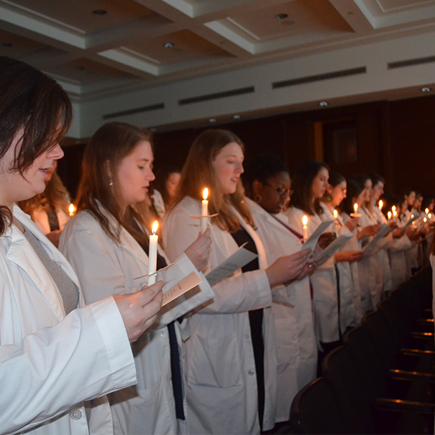 Johns Hopkins Students participate in the lighting of the lamp ceremony.